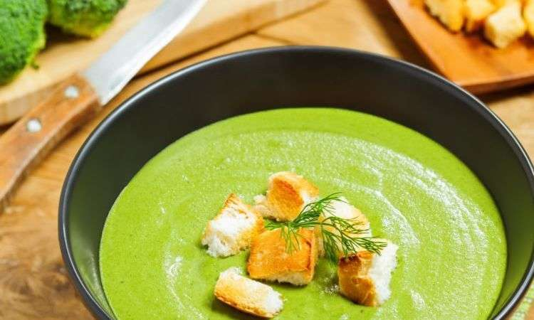 Visual cream of spring vegetable soup finished with a sprig of dill
