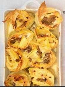 Girelle di lasagne al ragù bianco di carne efunghi
